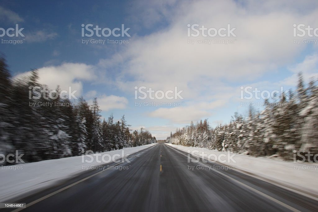 Speeding Down Country Road in Winter stock photo