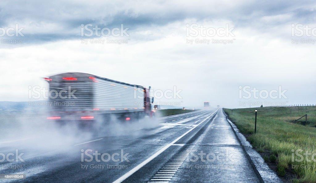 Speeding Expressway Tractor Trailer Trucks stock photo