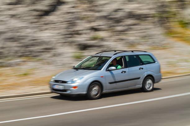 speeding ford focus on montenegro interurban road - ford focus stock photos and pictures