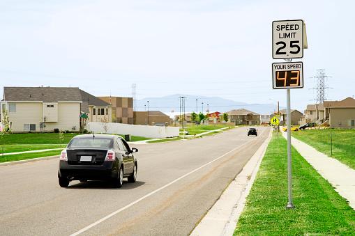 Photo of a motorist speeding in a residential school zone.