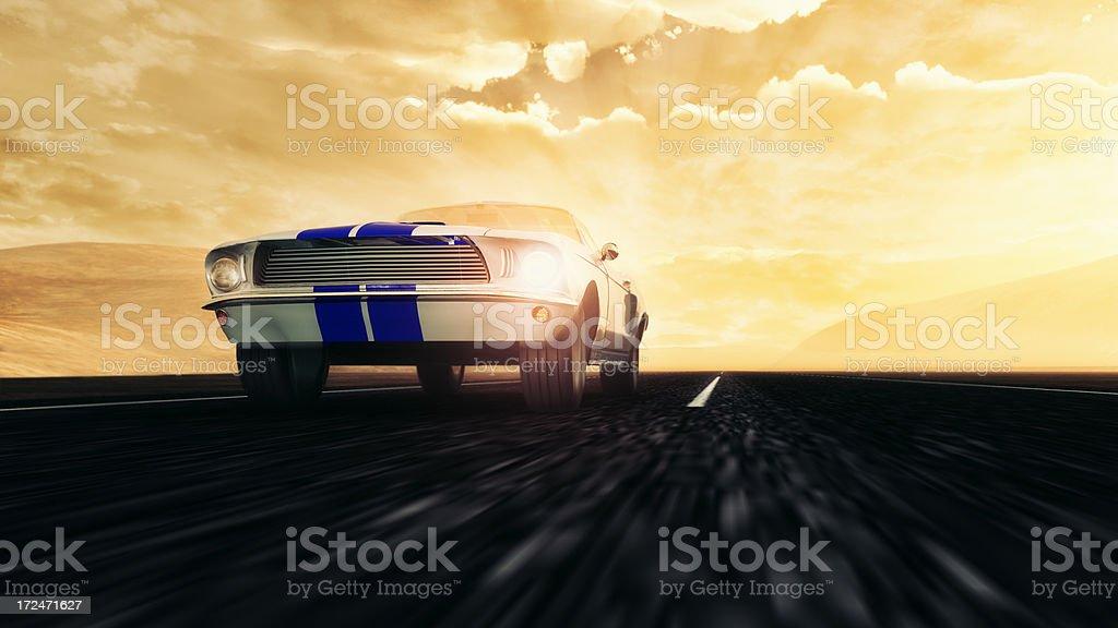 Speeding on empty dessert road old Ford Mustang 1966 model stock photo