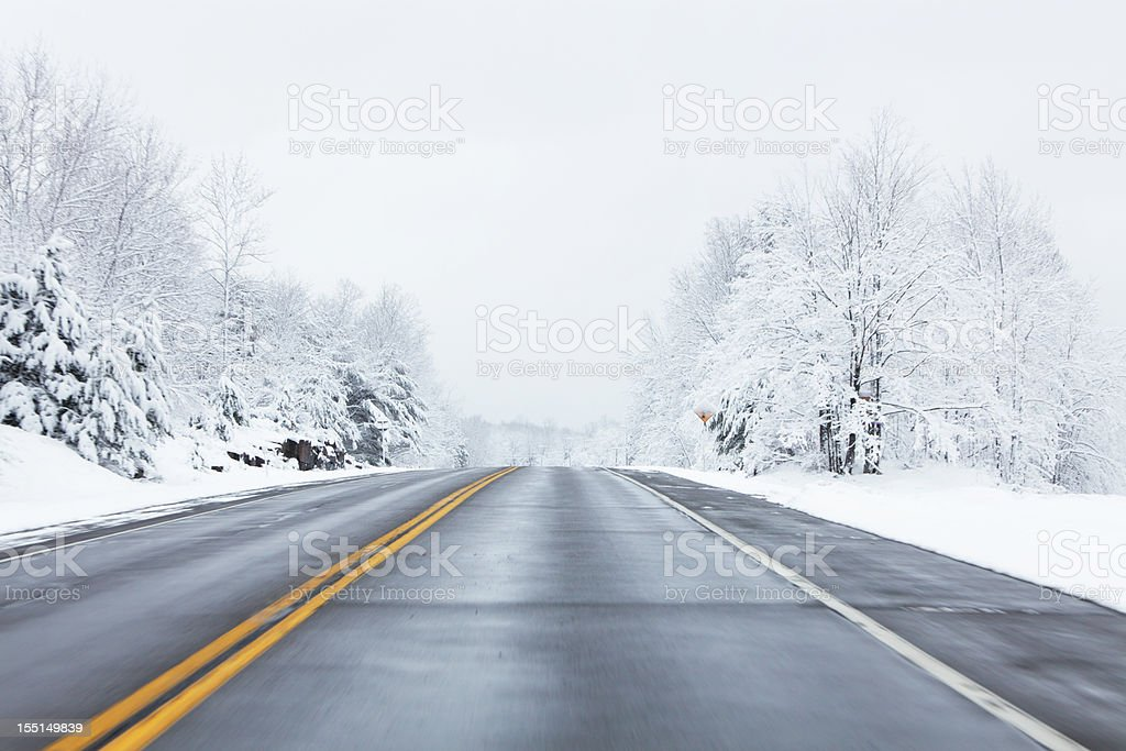 Speeding on Winter Highway stock photo