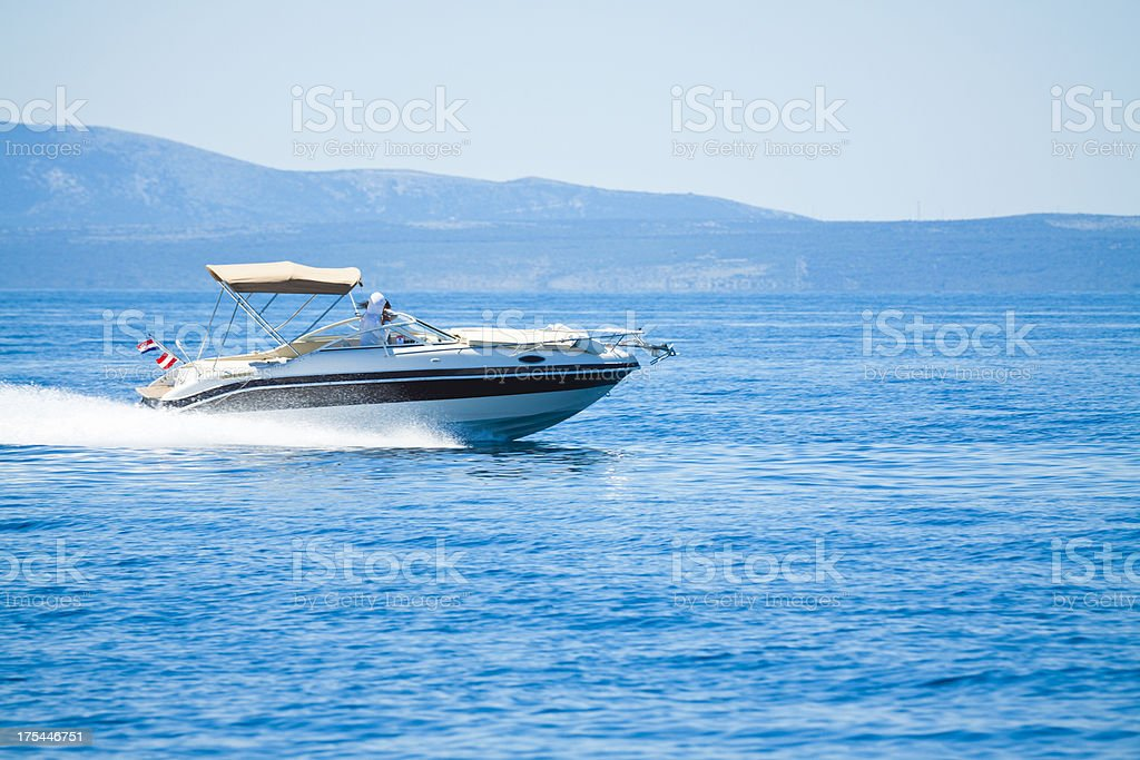 speeding power boat stock photo