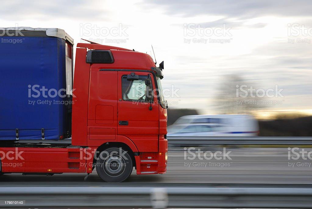 speeding red european truck stock photo