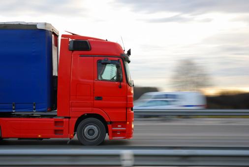 Speeding Red European Truck Stock Photo - Download Image Now