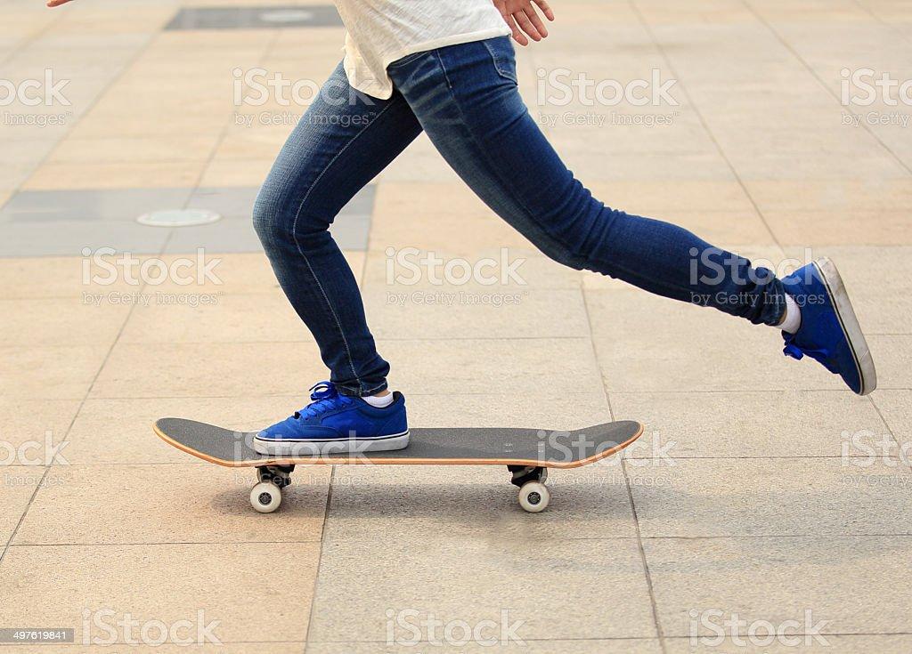 speeding skateboarding woman stock photo