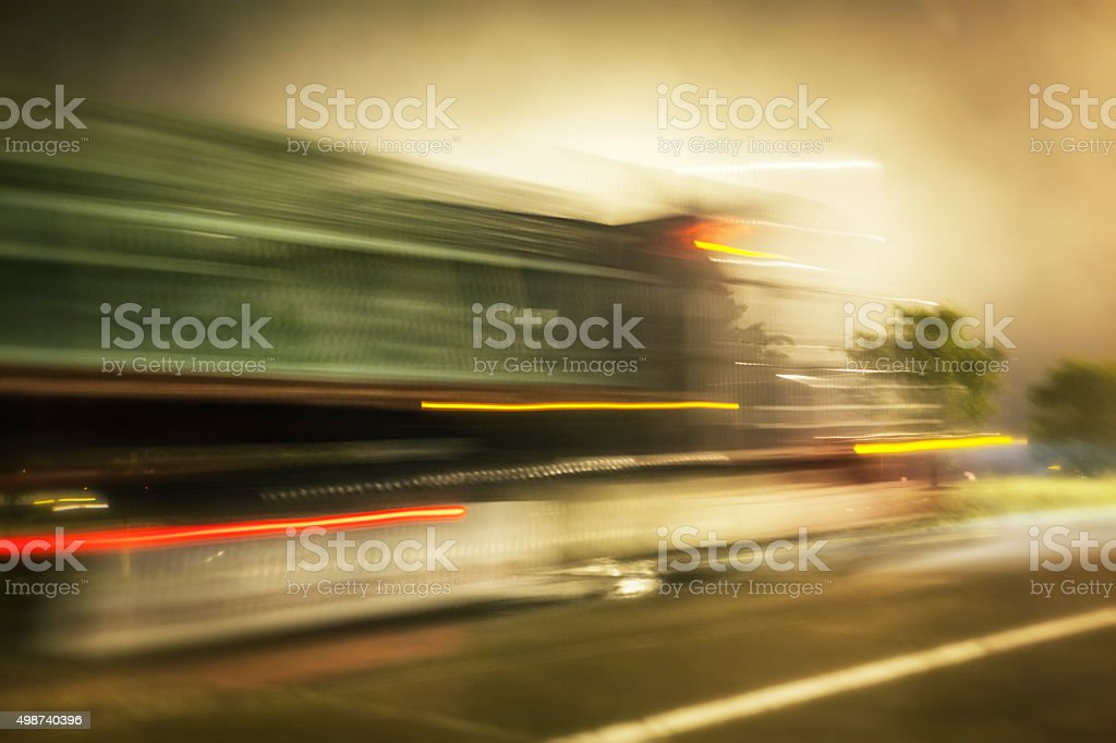 Speeding Streaking Motion Blur Night Time Tractor Trailer Truck stock photo