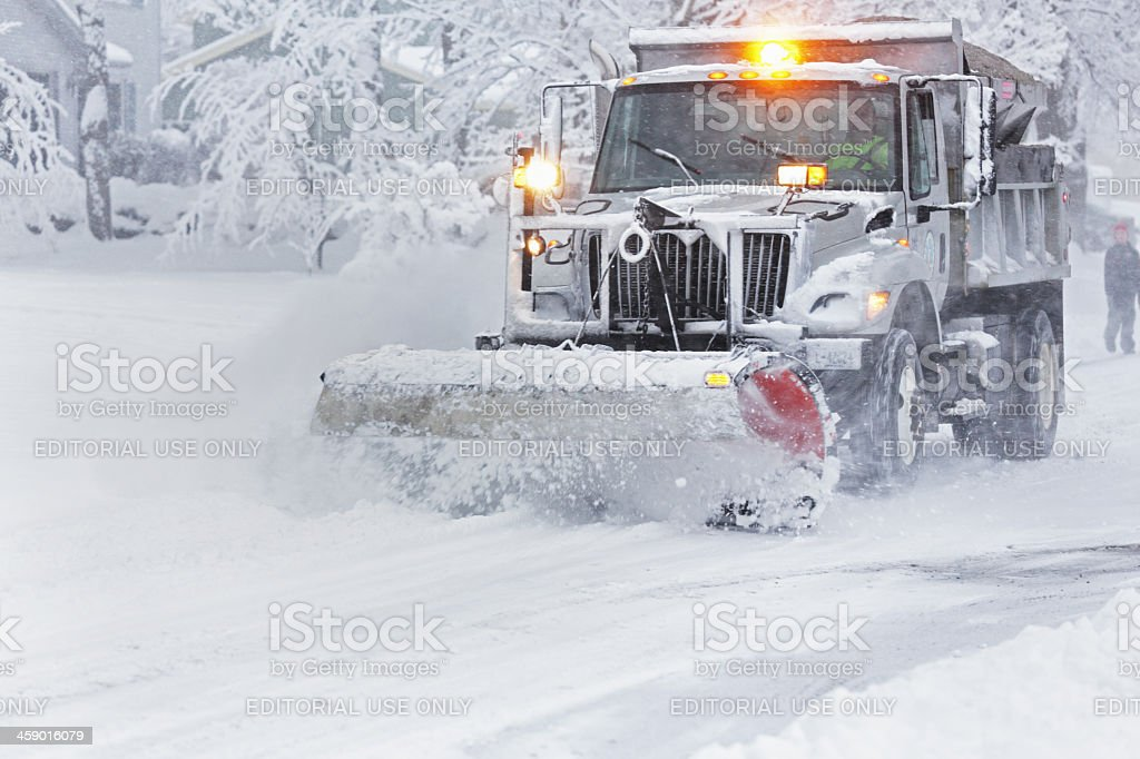 Speeding Suburban Snowplow stock photo