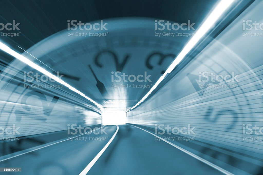 Speeding Through the Tunnel with Clock stock photo