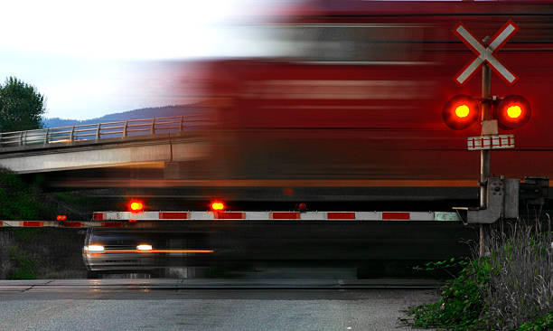 speeding train at railroad crossing, motion blur - railway signal stock photos and pictures