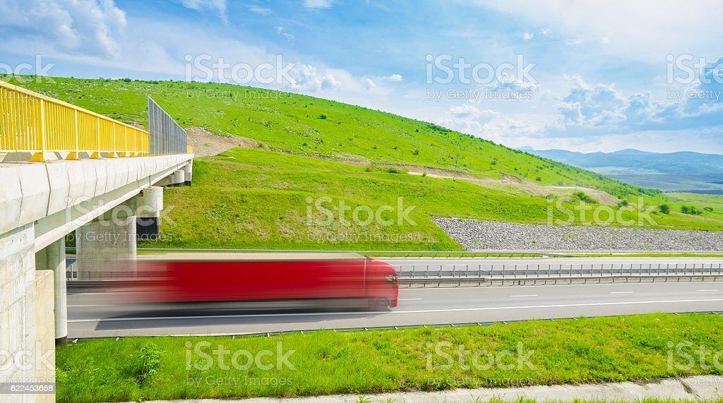 Speeding truck on highway stock photo
