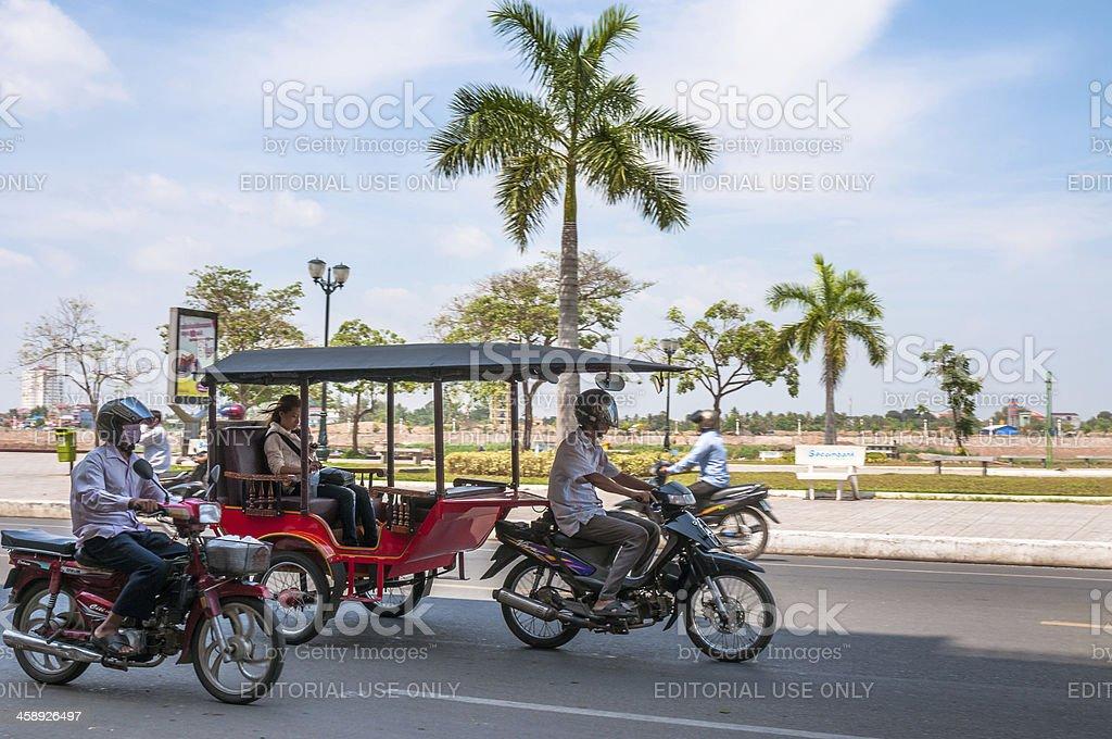 Speeding TukTuk In Phnom Penh, Cambodia stock photo