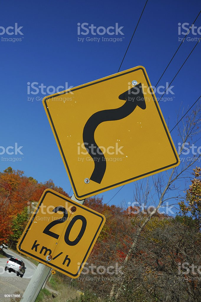 Speedlimit of 20km/h on a curving road stock photo