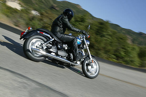 """Speedmaster action shot """"Ventura, California USA - April 19, 2005 : Triumph Speedmaster motorcycle action shot. Triumph is a Japanese motorcycle manufacture of cruiser and sport bike motorcycles. The Shadow is one of their cruiser models."""" kawasaki heavy industries stock pictures, royalty-free photos & images"""