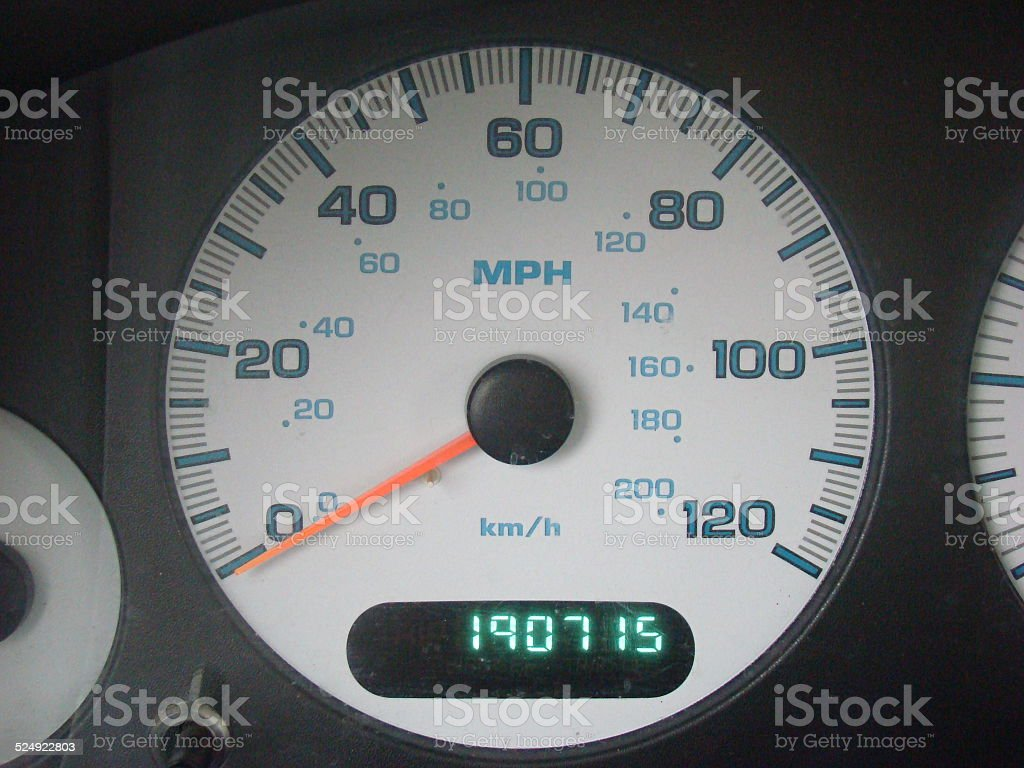 Speedometer and high mileage stock photo