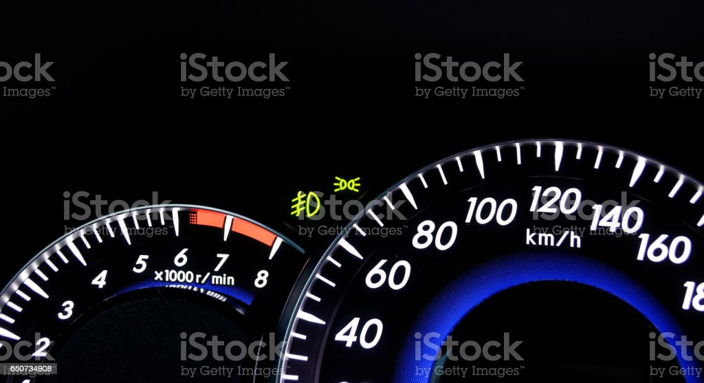 Speedometer and tachometer on the dashboard of a car stock photo
