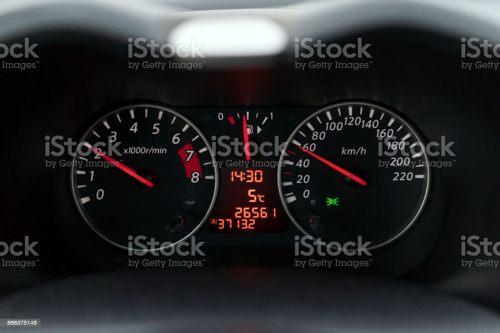 Speedometer in a car at a speed of sixty kilometers stock photo