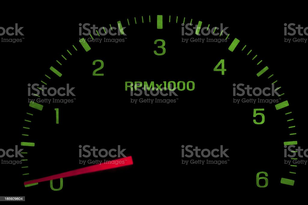Speedometer on black isolated royalty-free stock photo