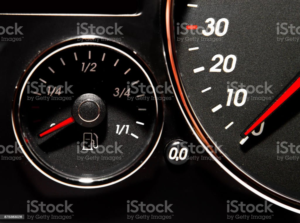 Speedometer with red arrow and chrome bezel stock photo