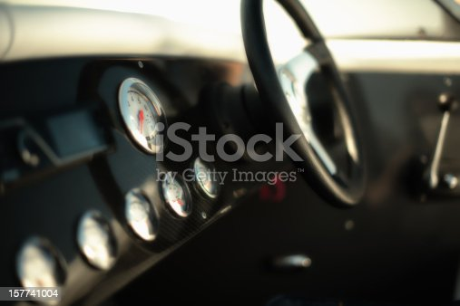 shot with lensbaby. Due to that very selective focus but beautiful blurred. detail from speedometer rpm, selective focus due to f1.4
