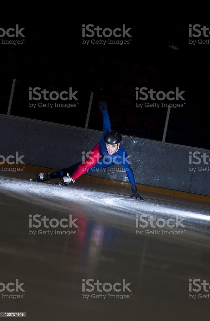 Speedskating in sharp turn royalty-free stock photo