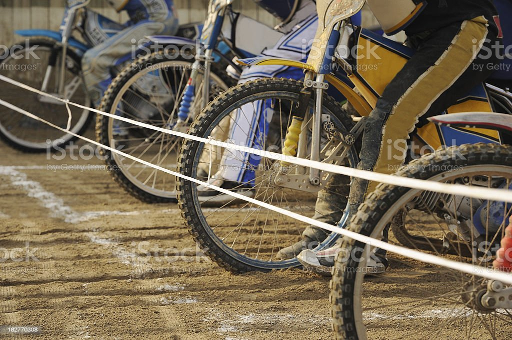 Speedway racers at start stock photo