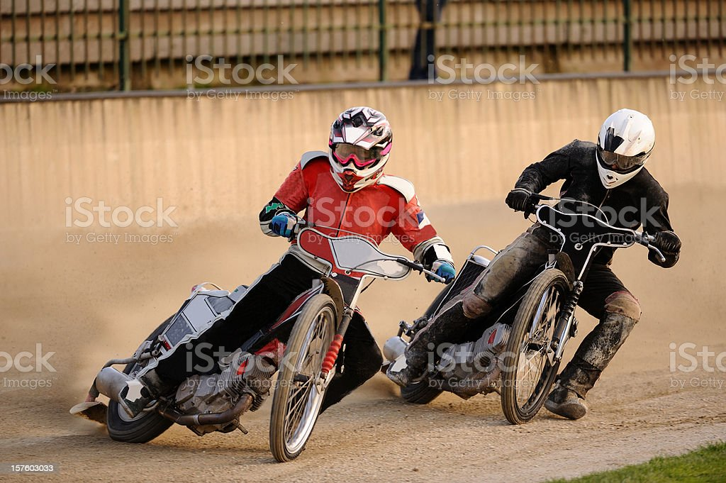 Speedway racers compeeting royalty-free stock photo