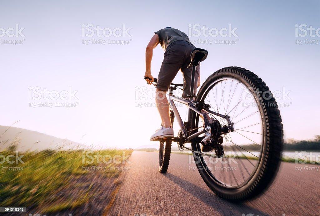 Speedy bicyclist stock photo