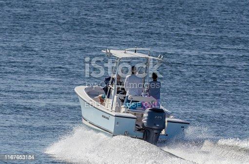 New Bedford, Massachusetts, USA - August 11, 2019: Center console boat cruising toward Buzzards Bay on summer morning