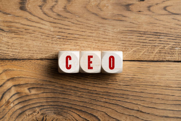 CEO spelled in red on three wooden blocks CEO spelled in red on three wooden blocks on wood surface ceo stock pictures, royalty-free photos & images