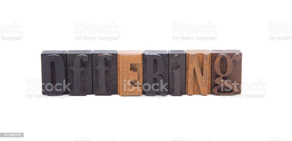 OFFERING spelled in wooden block letters - Great for church bulletins stock photo
