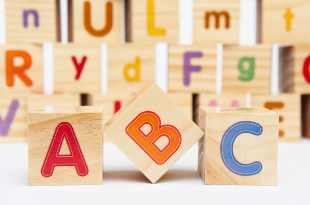 Spelling blocks toys with ABC in the foreground stock photo