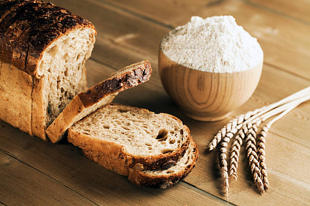 Spelt bread Loaf of spelt bread on wooden table spelt stock pictures, royalty-free photos & images