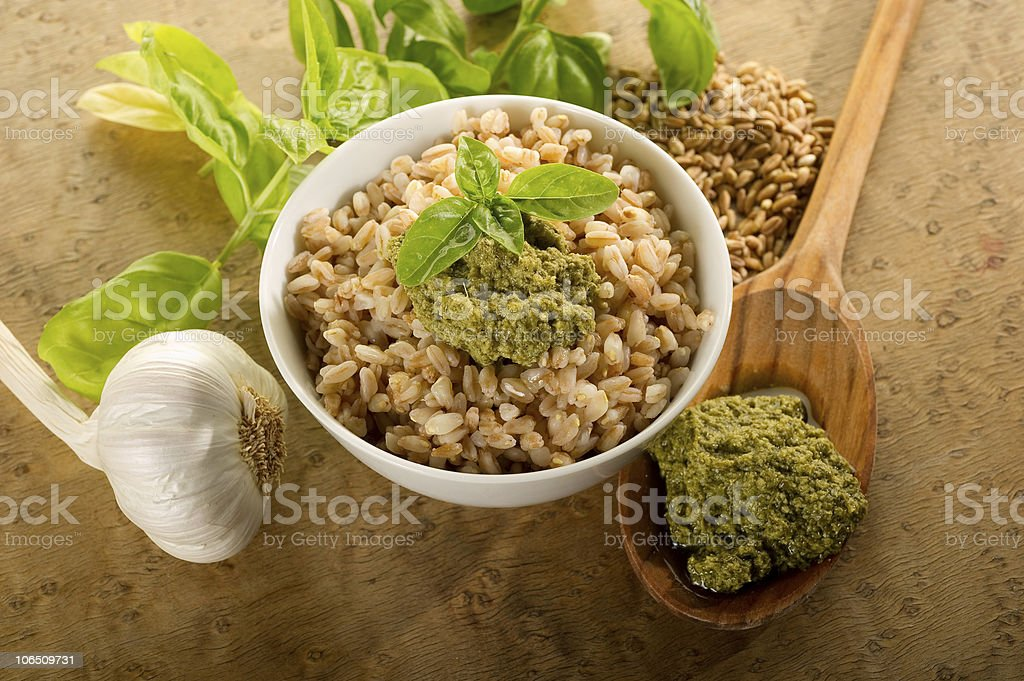 spelt on bowl with pesto sauce royalty-free stock photo