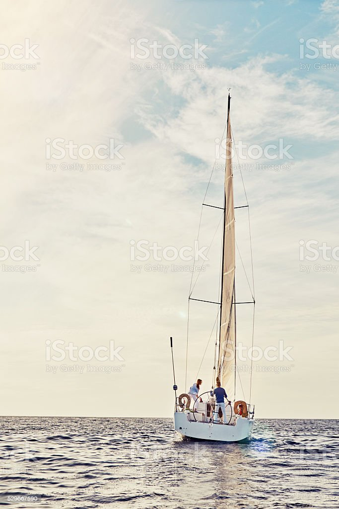 Spend more time sailing stock photo