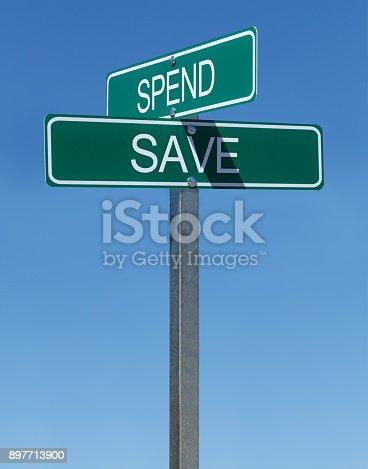 186103814istockphoto Spend Save Sign 897713900