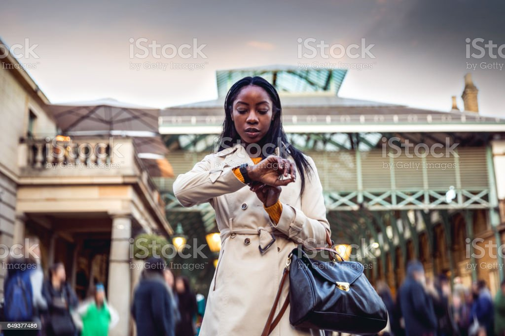 Spending a weekend in London, woman walking in downtown stock photo