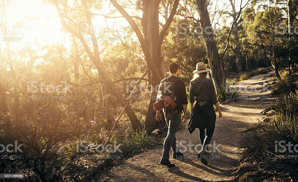 Shot of a couple going for a walk on a nature trail