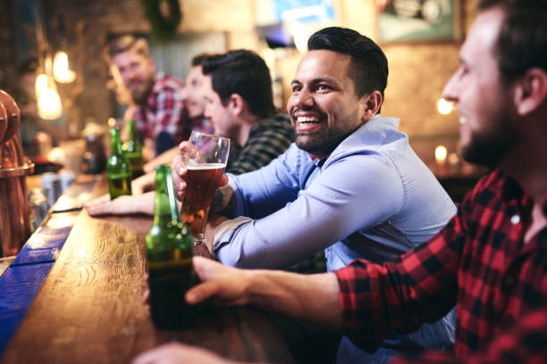 Spending leisure time in the pub Spending leisure time in the pub man cave stock pictures, royalty-free photos & images