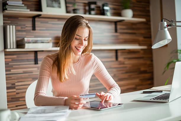 Spending money online stock photo