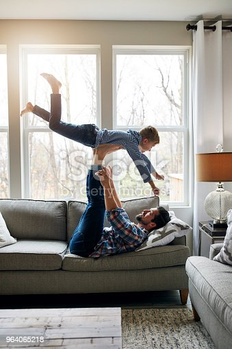Shot of a father and his little son having fun at home