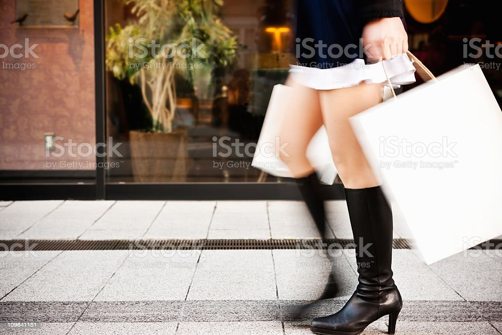 Spending Spree Woman Shopping Rushing with Paper Bags Motion Blur royalty-free stock photo