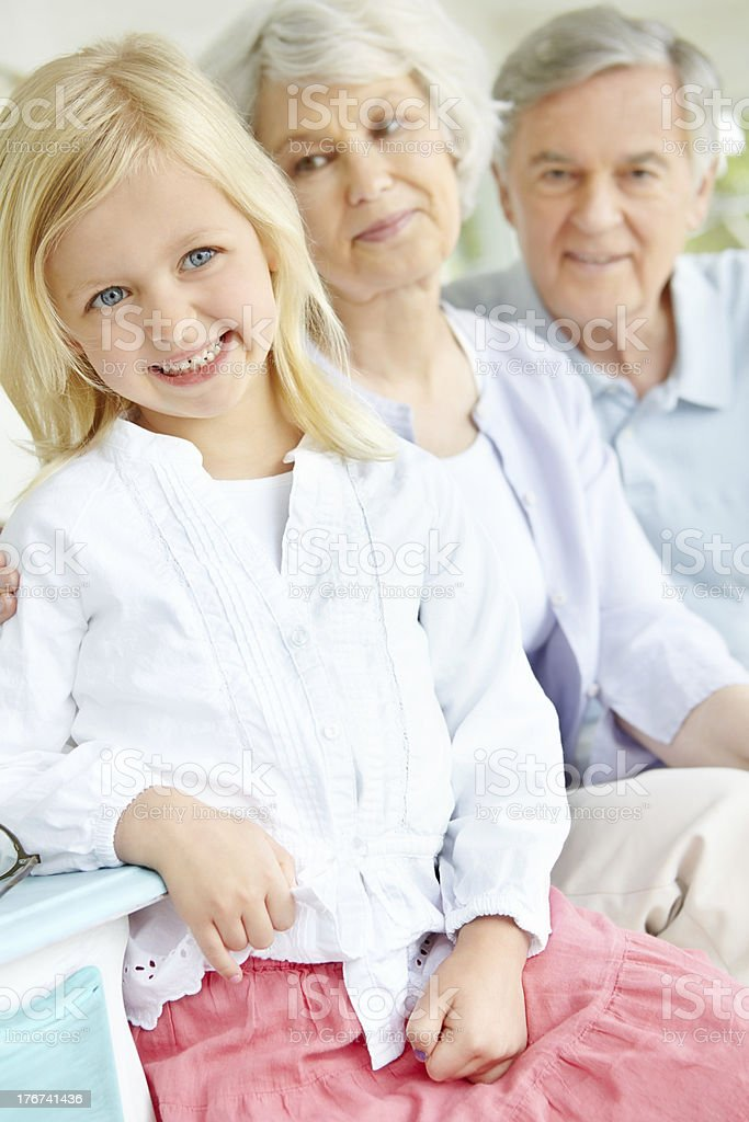 Spending the afternoon with her grandparents royalty-free stock photo
