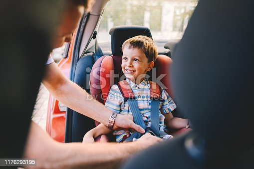 Father caring his kid to be safe during road trip