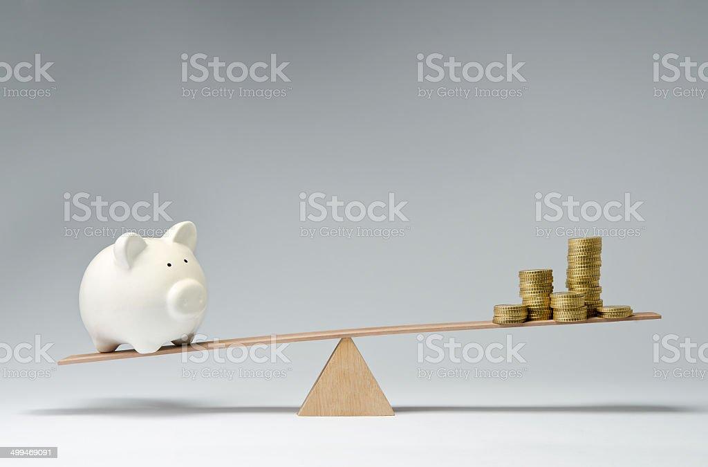 Spendings against savings stock photo