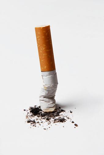 A cigarette butt,one cigarette on white background,spent cigarette,stop smoking.