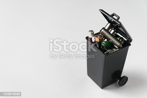 istock Spent finger-type batteries in the trash. Ecology recycling concept. Proper disposal of batteries and accumulators. 1223518282