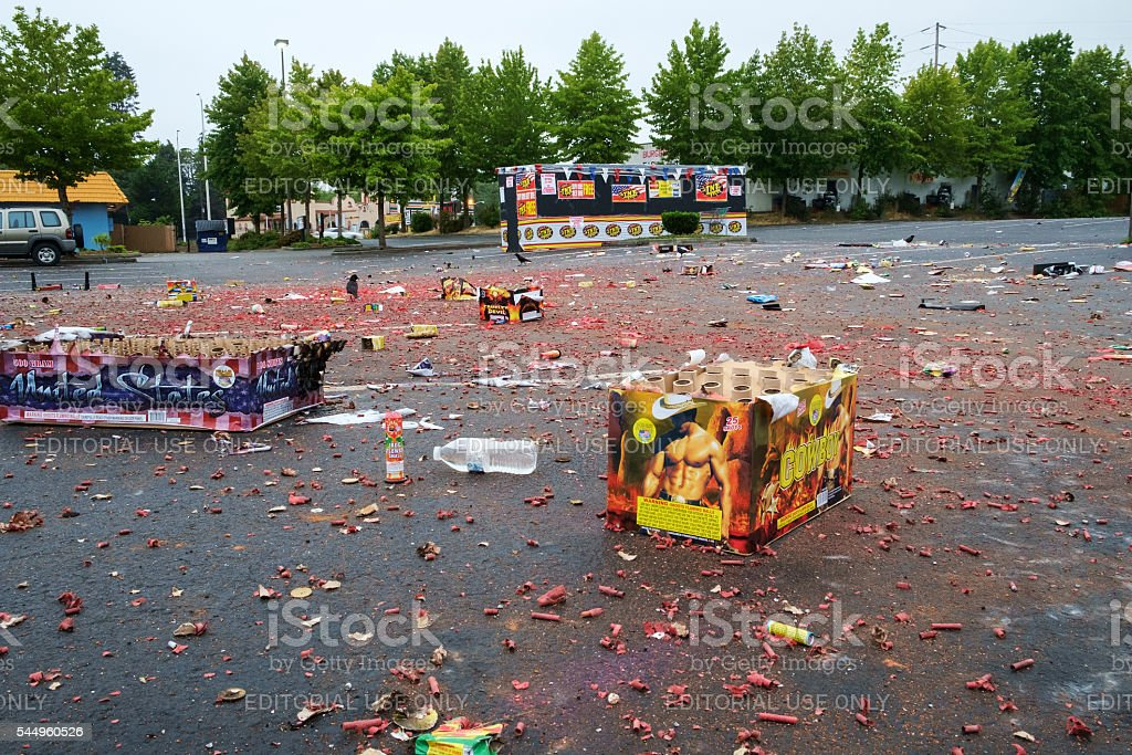 Spent fireworks in parking lot stock photo