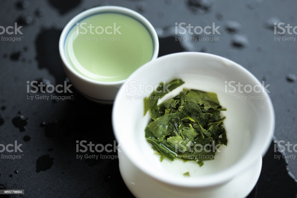 Spent Japanese sencha tea leaves in a gaiwan royalty-free stock photo