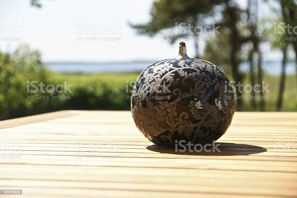 sperical oil lamp on the garden table royalty-free stock photo